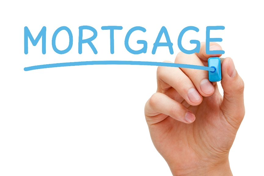 The word Mortgage being written out in blue marker
