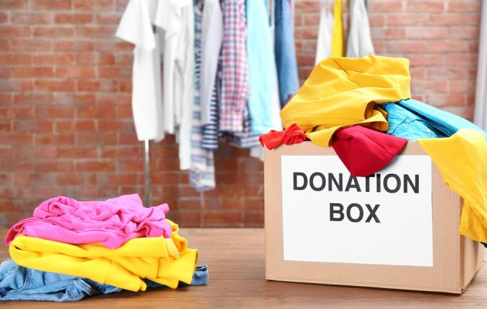 A donation box filled with clothes